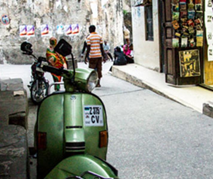 A classic street scene in Stone Town's narrow alleyways.