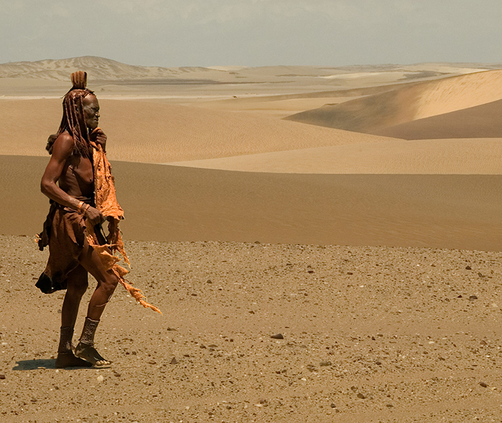 The Himba woman in this photograph captures the essence of this dry Namibian landscape.