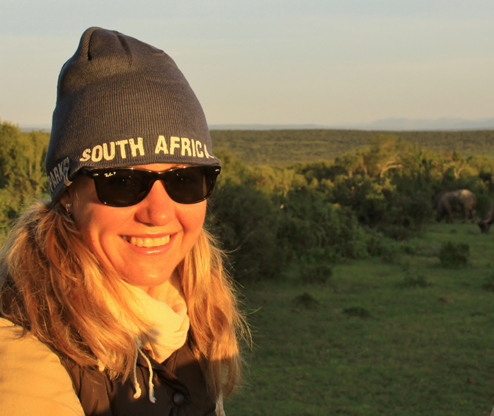 Go2African Angela spots a herd of buffalo on a dawn game drive.