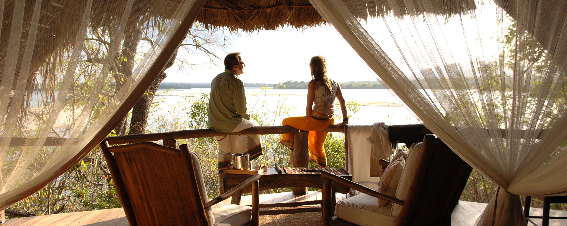 Wake up to the sun dancing on the Rufiji River in Selous National Park.