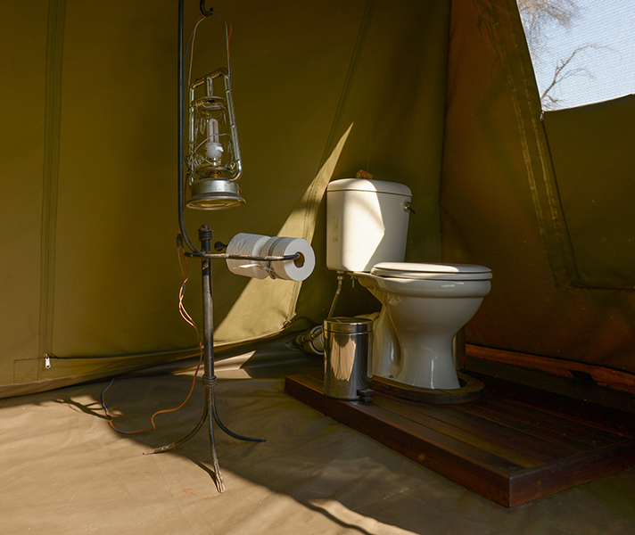 A private flush toilet is housed in a separate tent next to your bathroom area...