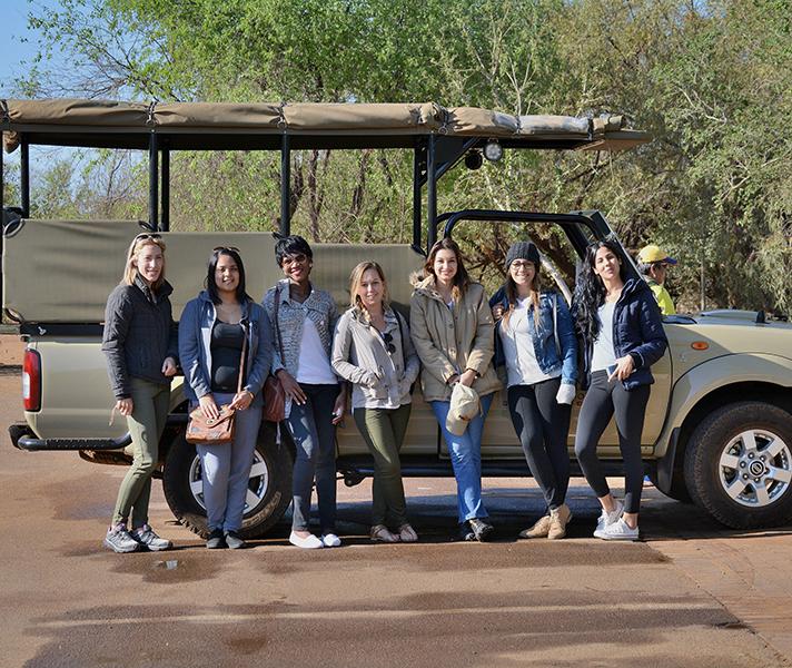 While colleagues Amanda, Shandre, Zandile, Tatham, Samantha, Jessica and Lee-Anne enjoy Pilanesberg National Park in South Africa.