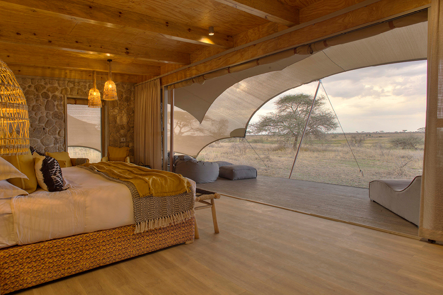 wetu_-_namiri_plains_-_tent_interior_looking_out_onto_the_plains