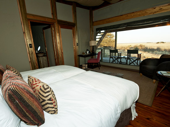 Wake up to the sight of the Kalahari's golden grasslands just steps away from your bed.