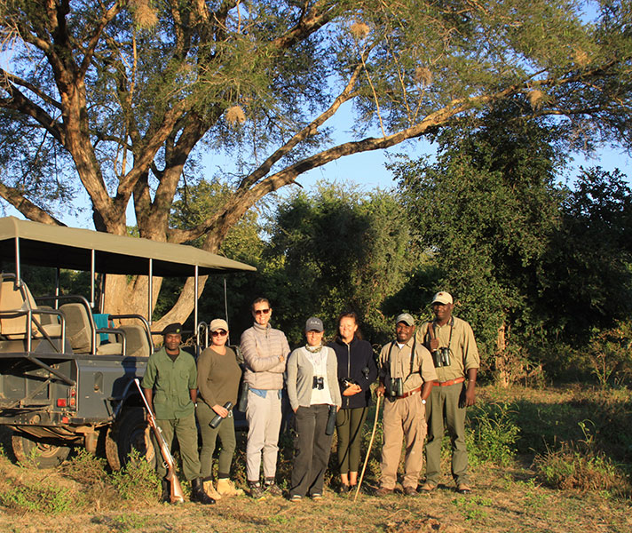 Setting off with our walking guides from Chongwe. Because you're in a national park, an armed park ranger must accompany you on your walk.