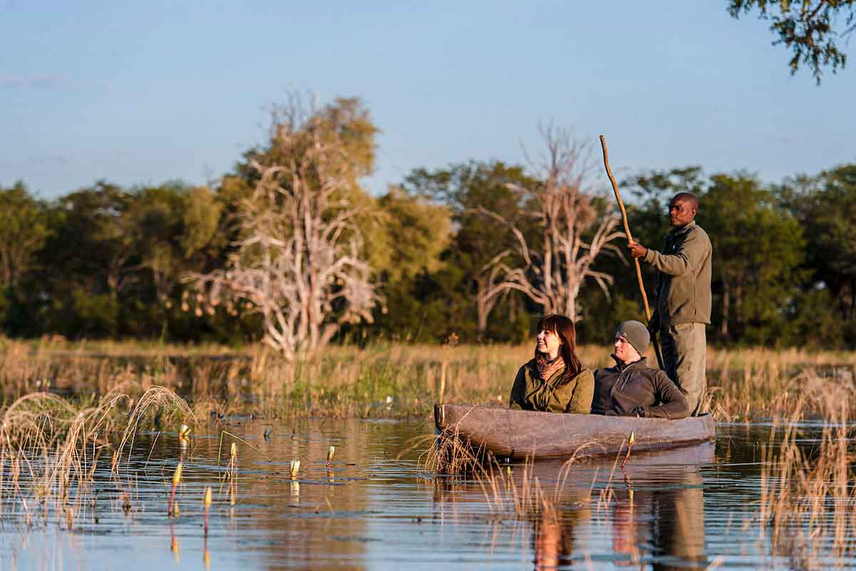 Honeymooners exploring the Okavango Delta on a mokoro, Botswana