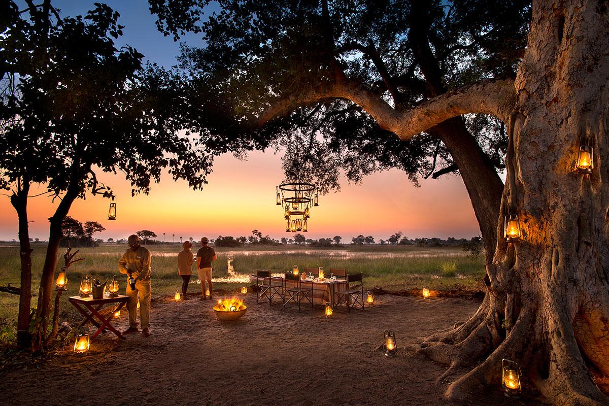 Sundowners at andBeyond Nxabega Okavango Tented Camp in the Okavango Delta, Botswana.