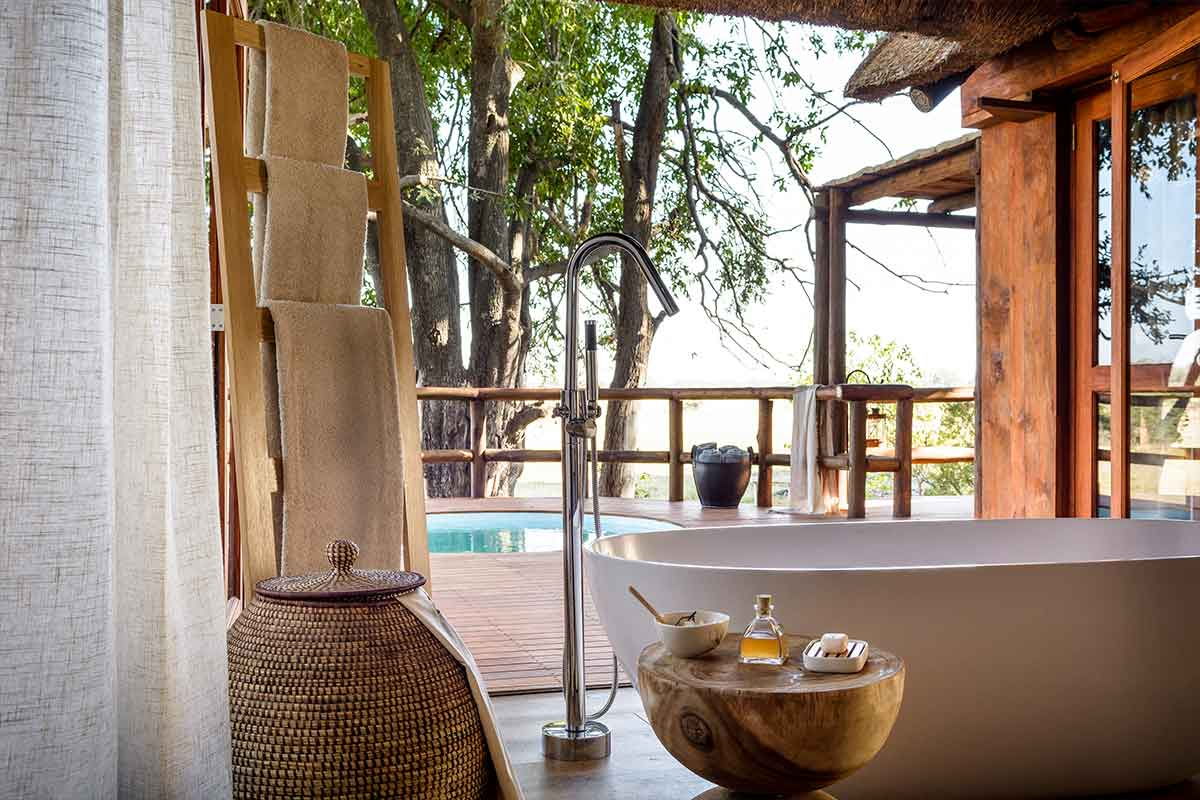 Luxurious bath and pool at Sanctuary Chief Camps, Botswana