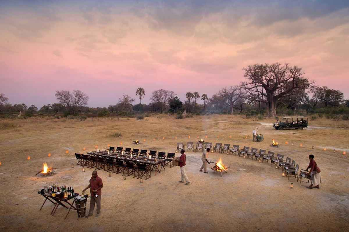Alfresco dining at Sandibe Okavango Safari Lodge, Botswana.