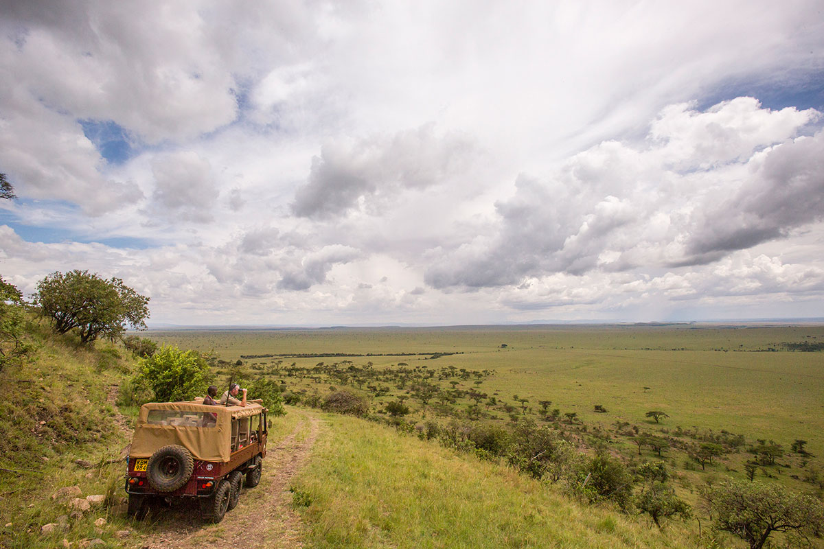 The expansive view of the Masai Mara from a safari vehicle in Kenya