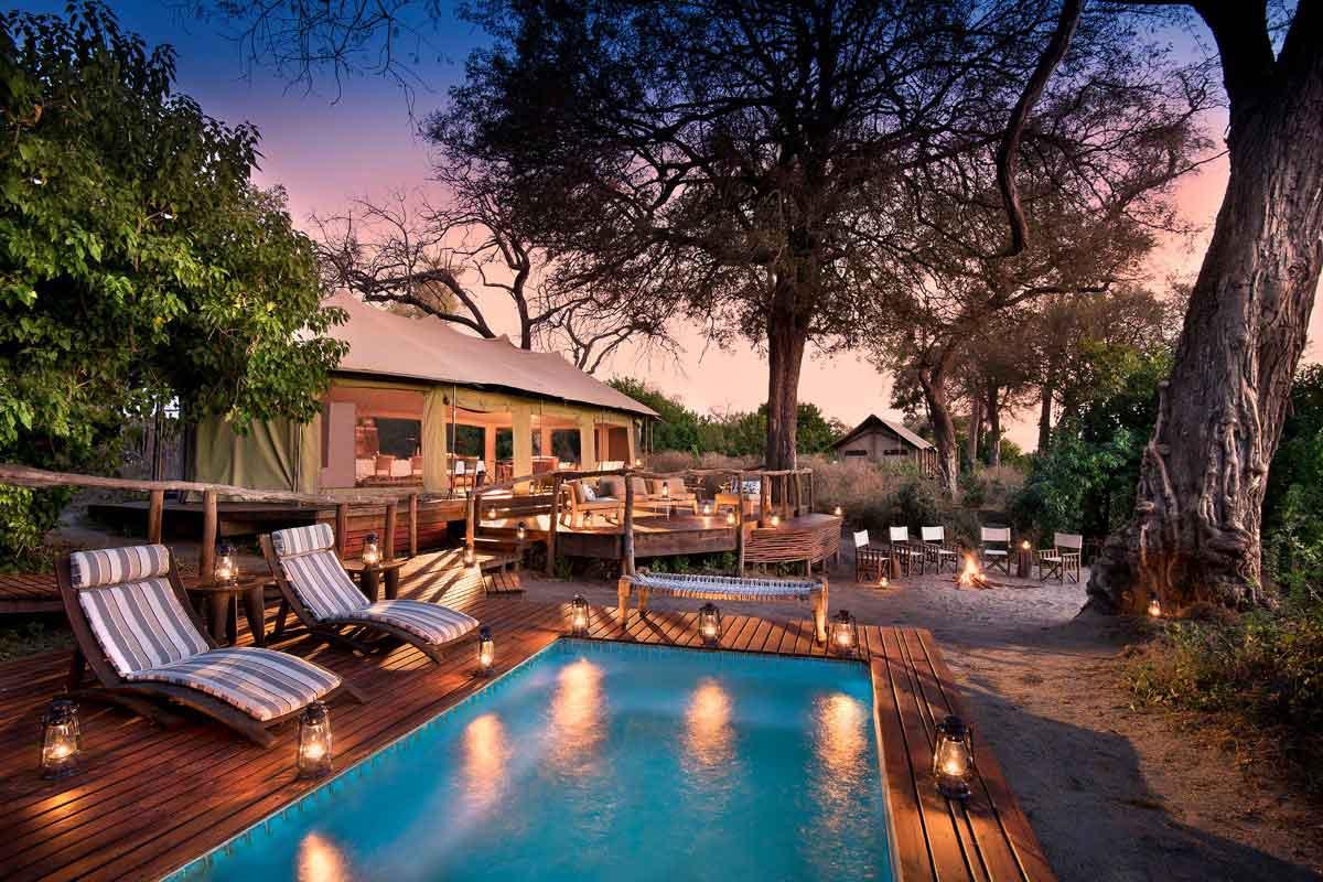 Swimming pool and tent exterior of Linyanti Ebony Camp, Botswana.