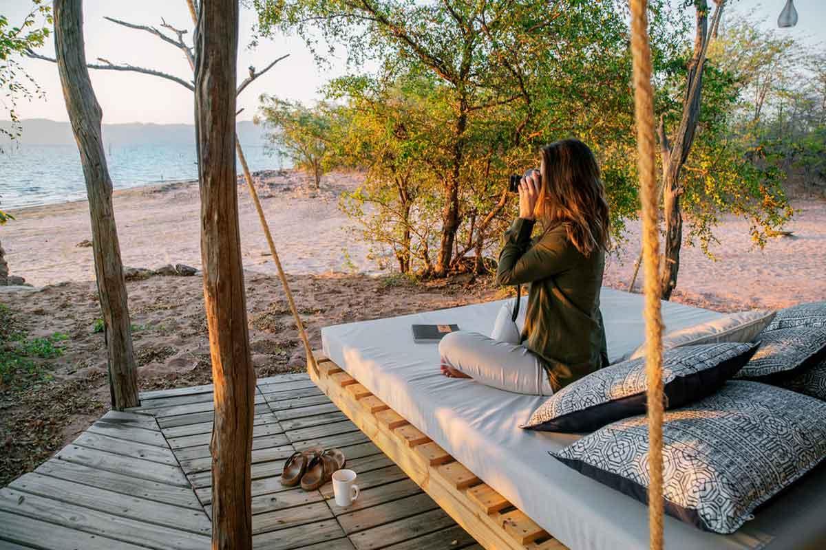 Guest taking in the sights of Lake Kariba from Changa Safari Camp in Matusadona National Park.