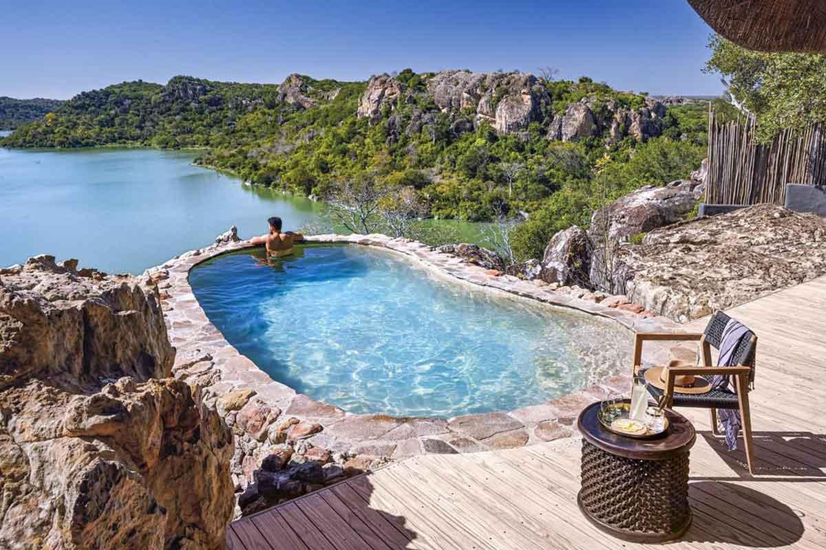 Perched high on a sandstone ridge, Singita Pamushana Lodge's shimmering swimming pool.