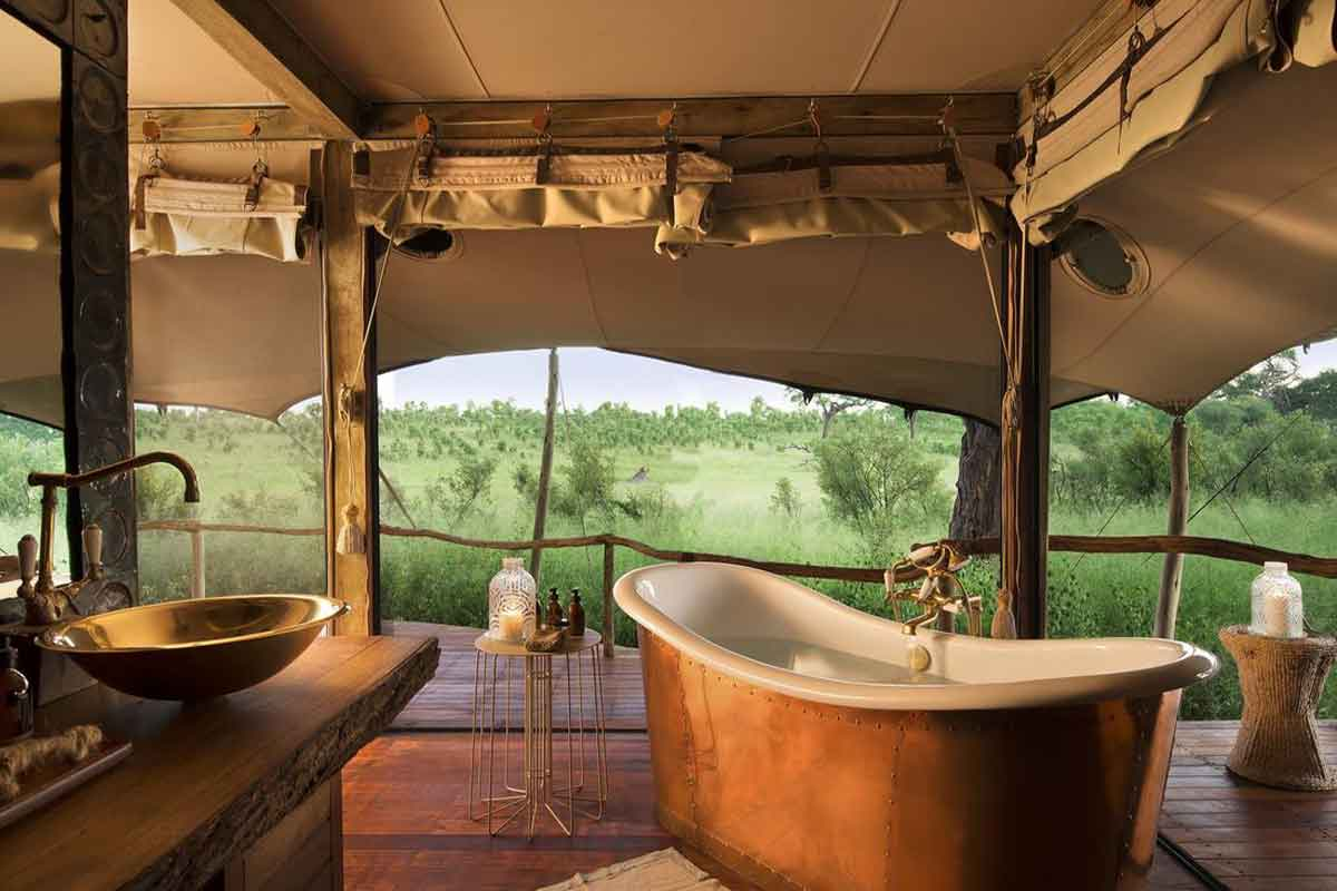 The en suite bathrooms at Somalisa Acacia in Hwange National Park have tubs encased in copper and stunning views.