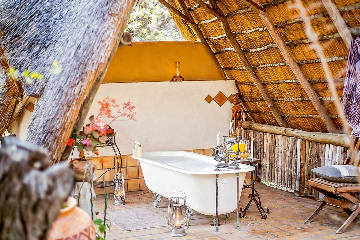 Your suites private outdoor bath at The Hide, Hwange National Park.