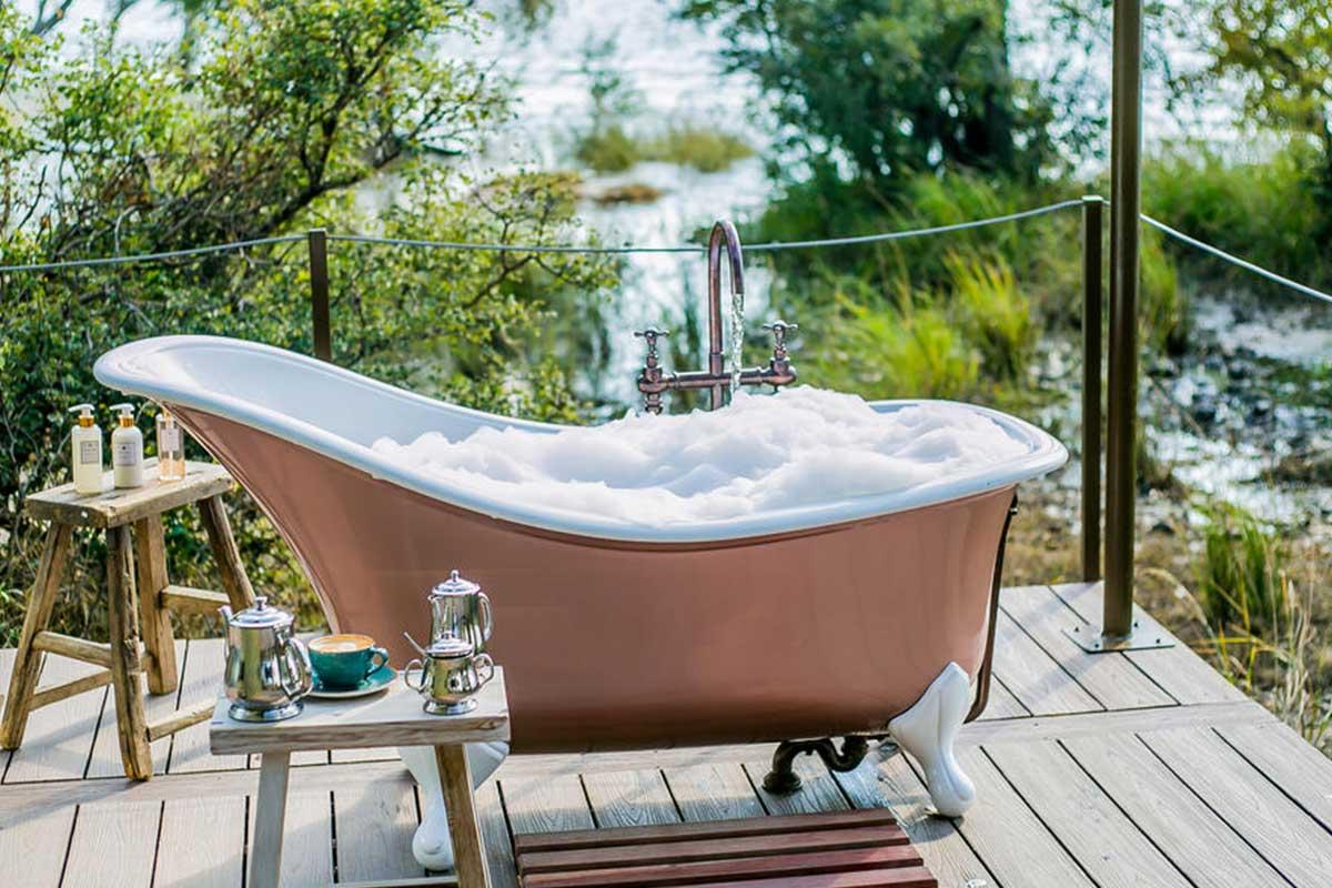 A bubble bath on the banks of the Zambezi River, at Old Drift Lodge.