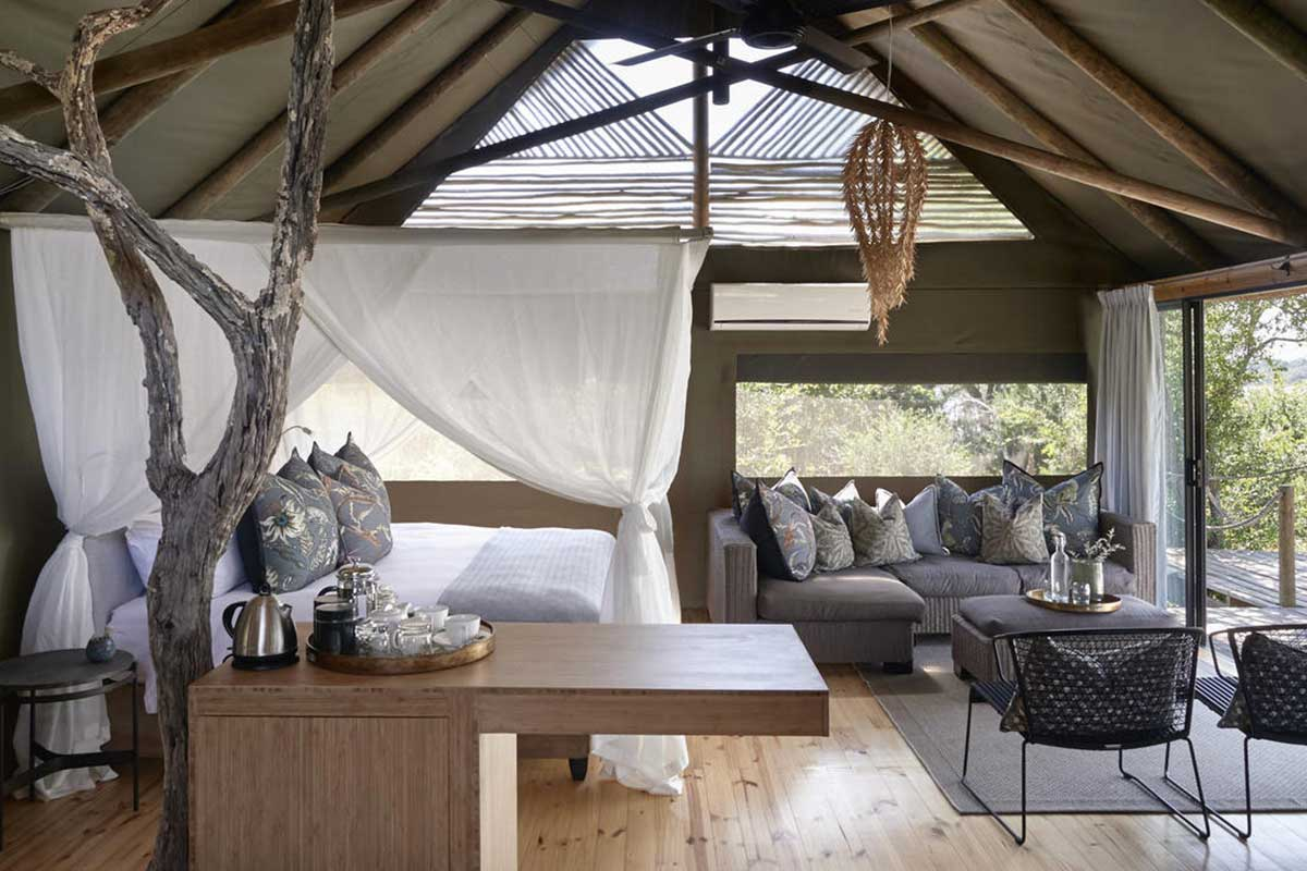 Neutral colour scheme tent interior at Victoria Falls River Lodge, Zimbabwe.