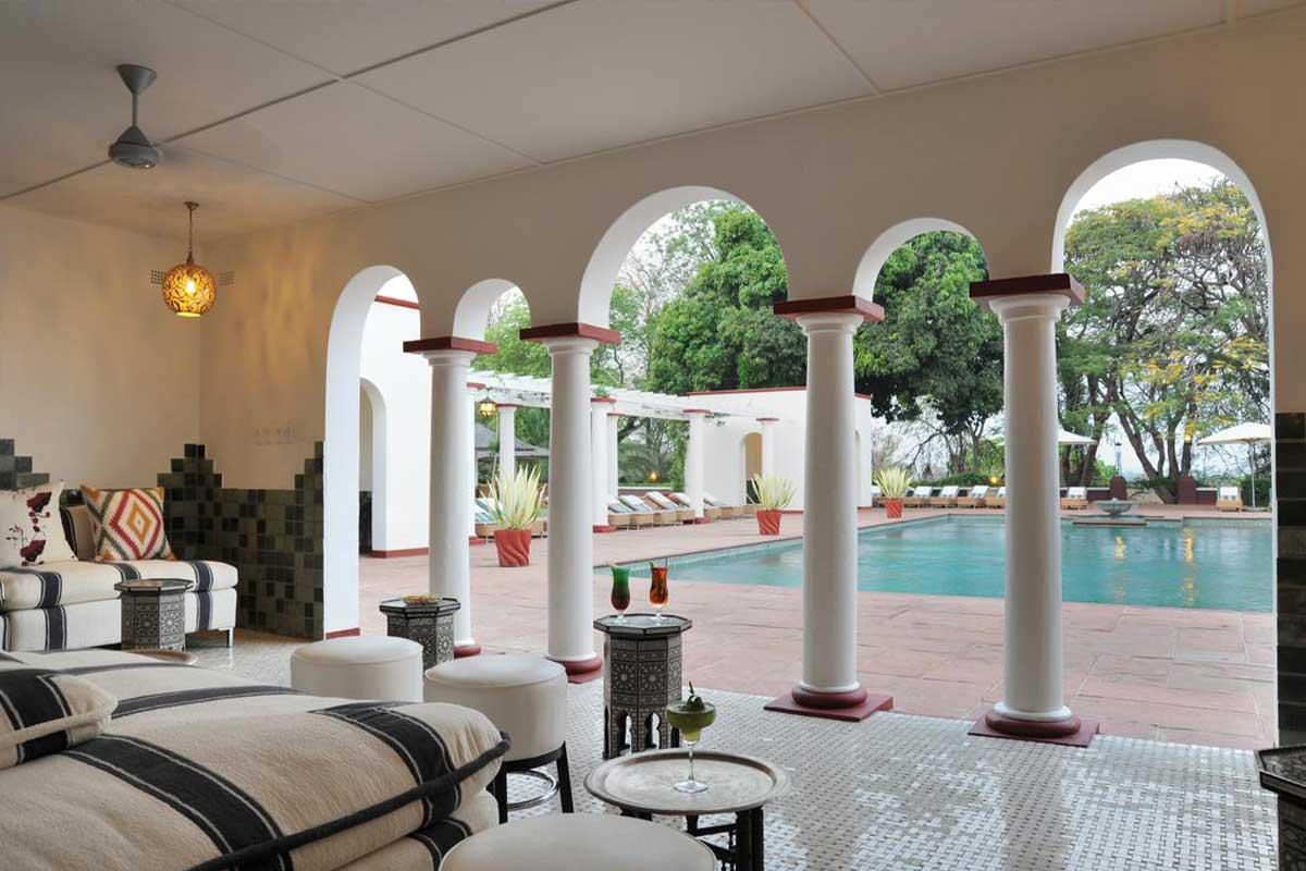 Victoria Falls Hotel's charming Edwardian-style pool lounge in Zimbabwe.