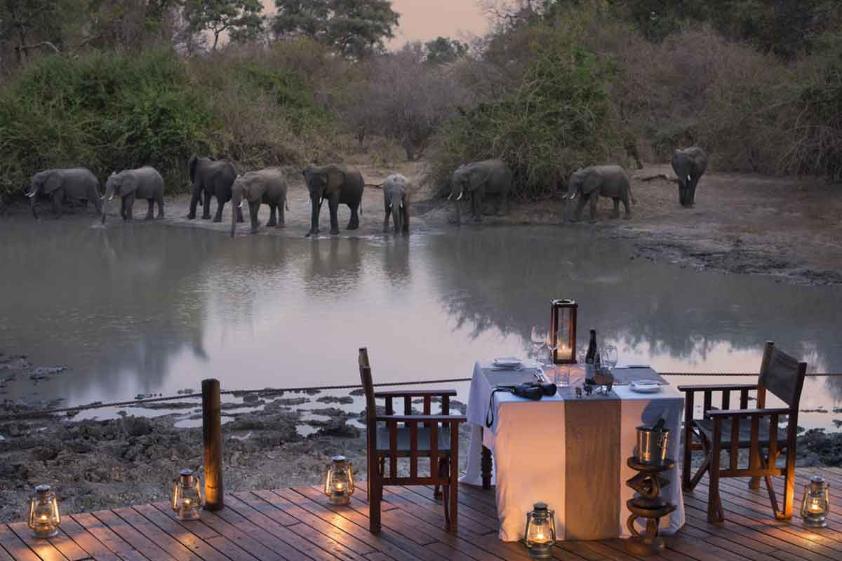 Dinner with a view of elephants at Kanga Camp, Mana Pools in northern Zimbabwe.
