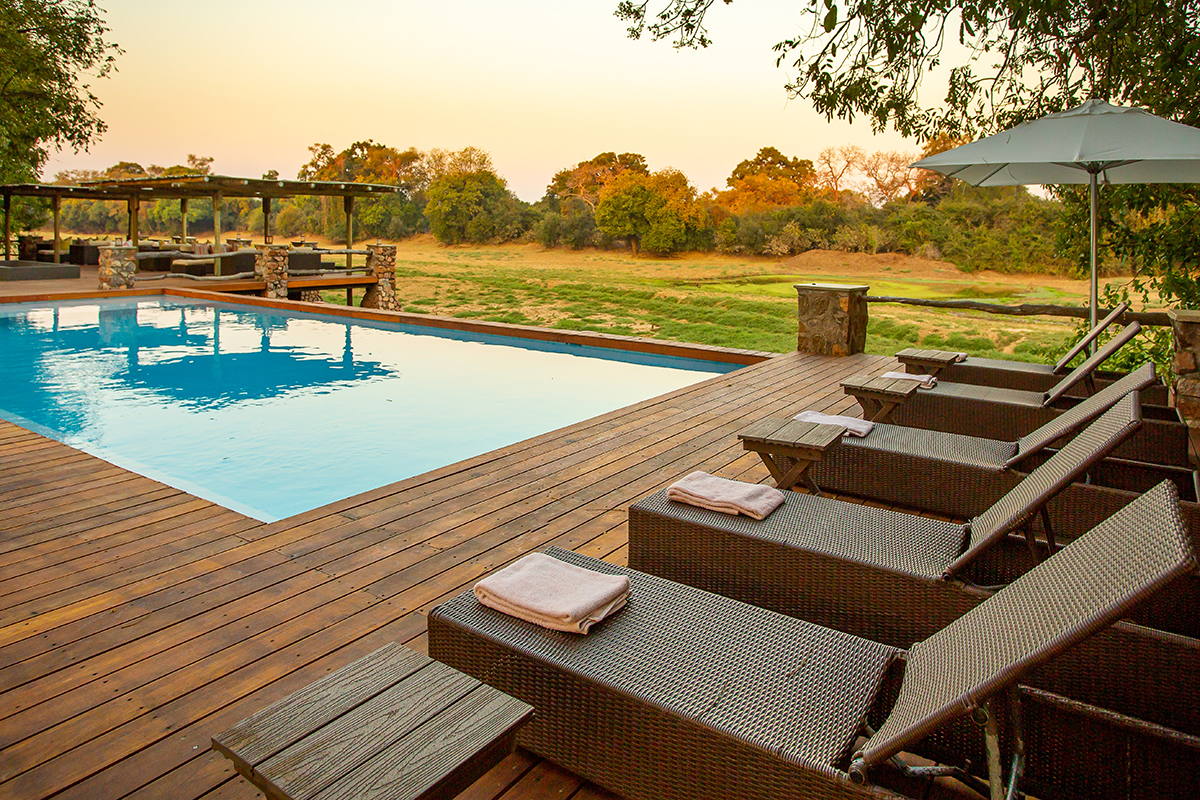 Mfuwe-THE-BUSHCAMP-COMPANY---Swimming-pool-&-deck-area