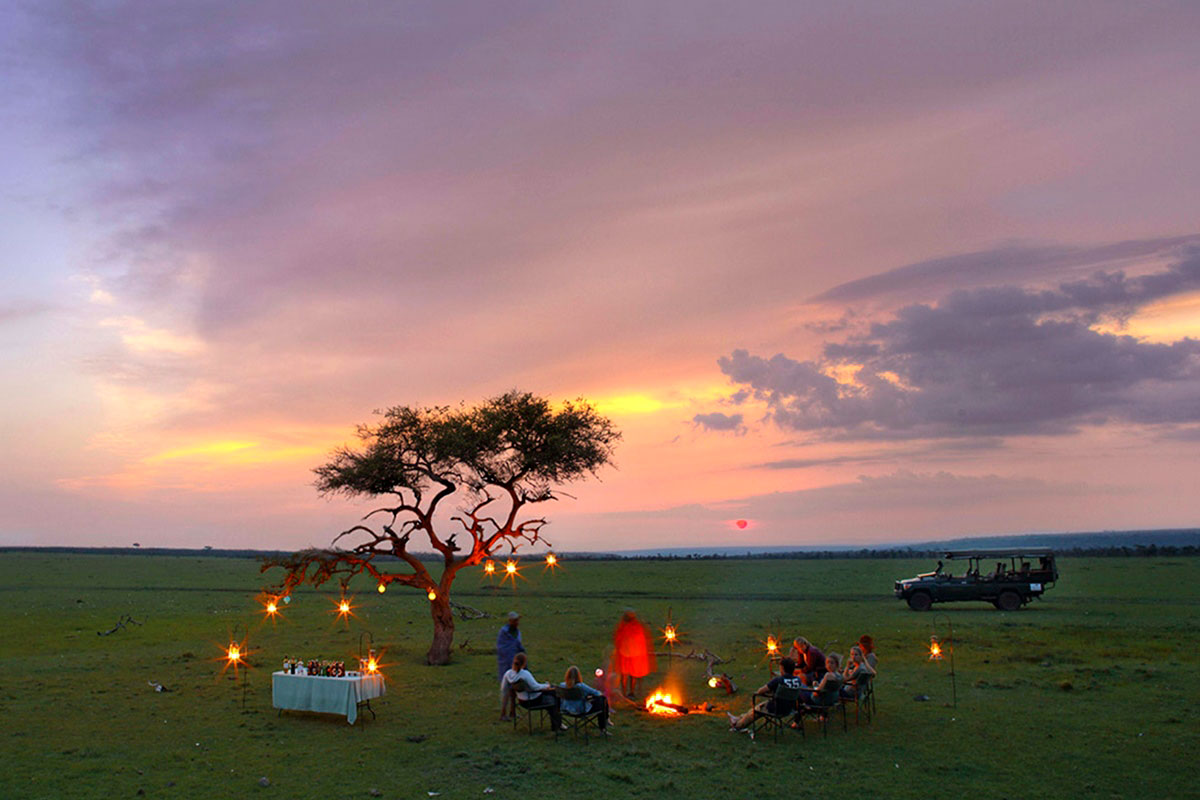 Enjoying sundowners on a private conservancy in the Masai Mara National Reserve